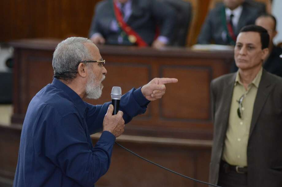 Egyptian Brotherhood's supreme guide Mohamed Badie (C) gestures as he talks to his judges during his trial in the capital Cairo on May 18, 2014. An Egyptian court today sentenced 126 supporters of ousted Islamist president Mohamed Morsi to 10 years in prison each over protest violence, judicial sources said. AFP PHOTO / AHMED GAMELAHMED GAMEL/AFP/Getty Images Photo: Ahmed Gamel, AFP/Getty Images