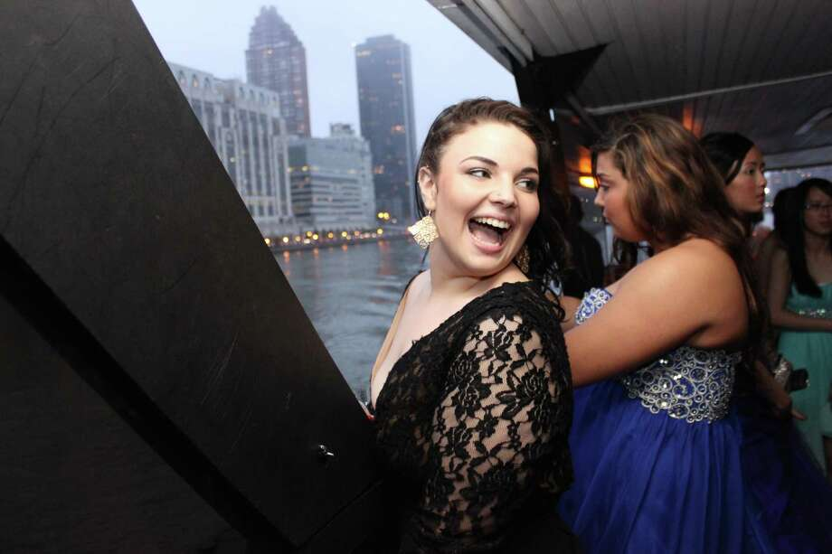 Umbrellas were this year's prom accessory at the Bethel High School senior prom on May 16. The festivities were held on a boat that left from Worlds Fair/Citifield Marina in Flushing, NY and cruised around the Statue of Liberty. Luckily the rain held off until the prom goers were all on the boat. Photo: Rebecca Lacey