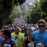 A view looking east on Hayes Street of the thousands of participants. The annual Bay to Breakers event in San Francisco, Calif. attracted thousands of runners and revelers as they made their way up the Hayes Street Hill Sunday May 18, 2014.