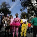 Some in costume just stopped and admired the other colorful runners. The annual Bay to Breakers event in San Francisco, Calif. attracted thousands of runners and revelers as they made their way up the Hayes Street Hill Sunday May 18, 2014.