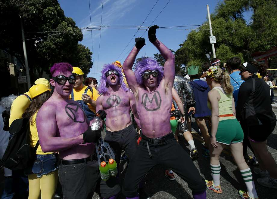 A group of purple people tried to get some attention near Fillmore Street. The annual Bay to Breakers event in San Francisco, Calif. attracted thousands of runners and revelers as they made their way up the Hayes Street Hill Sunday May 18, 2014. Photo: Brant Ward, The Chronicle