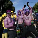 A group of purple people tried to get some attention near Fillmore Street. The annual Bay to Breakers event in San Francisco, Calif. attracted thousands of runners and revelers as they made their way up the Hayes Street Hill Sunday May 18, 2014.