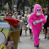 The pink gorilla, a regular at the event, stood out from the crowd. The annual Bay to Breakers event in San Francisco, Calif. attracted thousands of runners and revelers as they made their way up the Hayes Street hill Sunday May 18, 2014.
