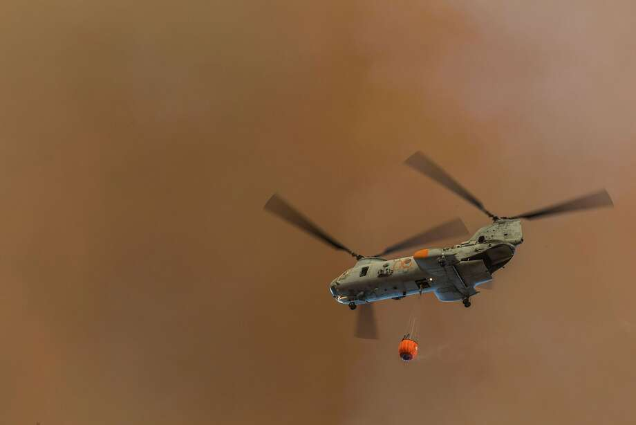 "This May 16, 2014 US Marine Corps photo shows a CH-46 Sea Knight helicopter providing aerial support to extinguish the Las Pulgas Wildfire within the area of Marine Corps Airstation Camp Pendleton, California. The Las Pulgas Wildfire on Camp Pendleton has burned more than 15,000 acres and is the largest fire in San Diego County history. AFP PHOTO / HANDOUT / US Marine Corps / Cpl. Matthew Howe      == RESTRICTED TO EDITORIAL USE / MANDATORY CREDIT: ""AFP PHOTO HANDOUT- US Marine Corps / Cpl. Matthew Howe ""/ NO MARKETING - NO ADVERTISING CAMPAIGNS  NO A LA CARTE SALES / DISTRIBUTED AS A SERVICE TO CLIENTS == Cpl. Matthew Howe/AFP/Getty Images Photo: Cpl. Matthew Howe, AFP/Getty Images"
