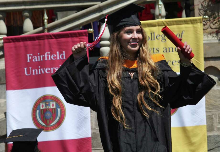 Graduate Caroline Pruski, of Farmington,  receives her diploma at Fairfield University's sixty fourth commencement exercises on Sunday, May 18, 2014. Photo: BK Angeletti, B.K. Angeletti / Connecticut Post freelance B.K. Angeletti