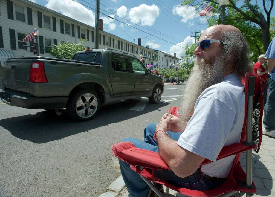 Brad Rodrigues, 66, of danbury, wait for the annual Memorial Day Parade to start on Sunday afternoon, May 18, 2014, in Bethel, Conn Rodrigues was there to watch his grandson march in the parade with the Bethel Middle School Band. Photo: H John Voorhees III / The News-Times Freelance