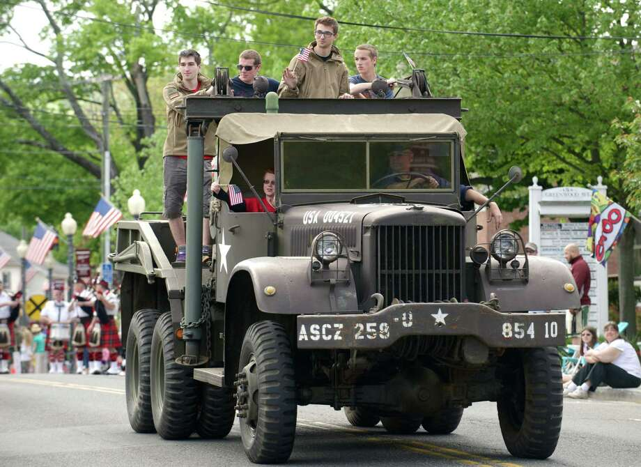 The Annual Memorial Day Parade makes its way through downtown Bethel, Conn, on Sunday afternoon, May 18, 2014. Consisting of marching bands, military vehicles, sports teams, scouts, veterans and more the parade ended at the Hurgin Municipal Center where services were held on the front steps. Photo: H John Voorhees III / The News-Times Freelance