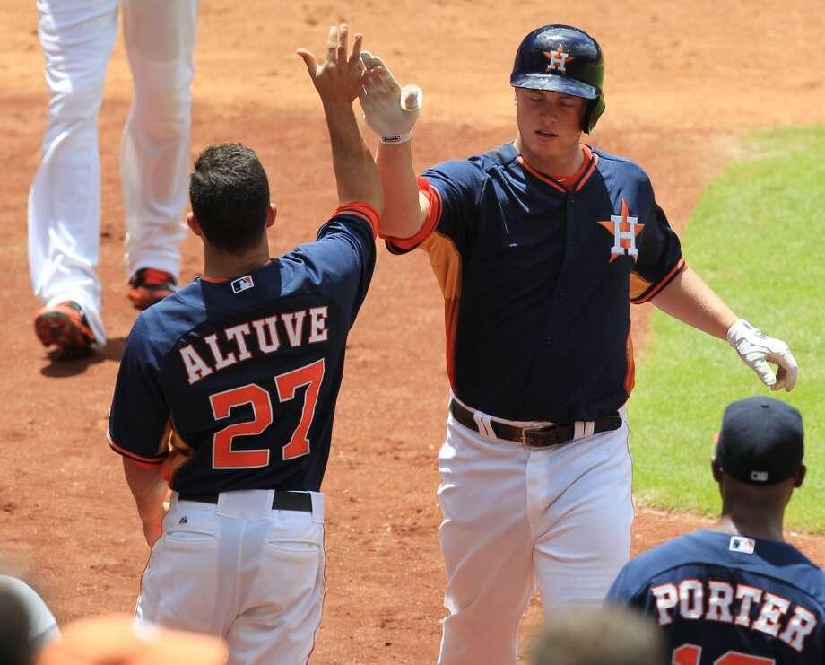 Jose Altuve and Matt Dominguez celebrate after scoring. Photo: Mayra Beltran, Houston Chronicle
