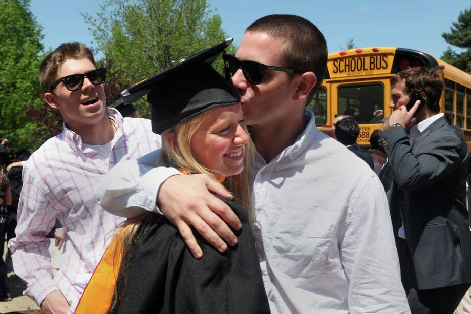 Spencer Everts gives graduate Kelly Herdman a kiss after Fairfield University's sixty fourth commencement exercises on Sunday, May 18, 2014. Photo: BK Angeletti, B.K. Angeletti / Connecticut Post freelance B.K. Angeletti