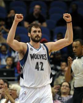 Minnesota Timberwolves forward Kevin Love (42) celebrates in an NBA basketball game against the San Antonio Spurs at the Target Center on in Minneapolis on Tuesday, April 8, 2014. (AP Photo/Hannah Foslien)