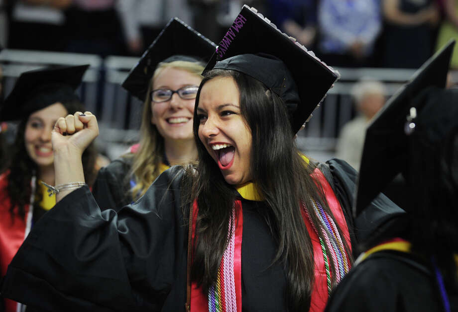 Graduate Katherine Boeglin, of Pawling, NY, gestures to the crowd during the procession in to the Sacred Heart University graduation at the Webster Bank Arena in Bridgeport, Conn. on Sunday, May 18, 2014. Photo: Brian A. Pounds / Connecticut Post