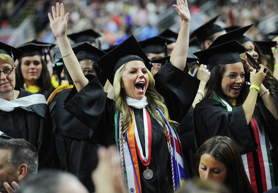Graduate Lauren Kalil celebrates during the Sacred Heart University graduation at the Webster Bank Arena in Bridgeport, Conn. on Sunday, May 18, 2014. Photo: Brian A. Pounds / Connecticut Post