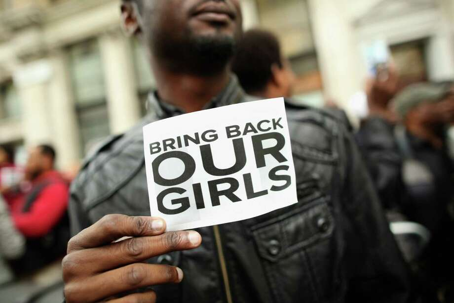 LONDON, ENGLAND - MAY 09:  A man holds a sign that reads 'Bring back our girls' during a protest outside Nigeria House on May 9, 2014 in London, England. 276 schoolgirls were abducted from their boarding school on 14 April, 2014 in the town of Chibok in north-eastern Borno state in Nigeria. The abductions have sparked protests around the world calling for the release of the girls who are being held by the militant group Boko Haram. (Photo by Dan Kitwood/Getty Images) ORG XMIT: 489611027 Photo: Dan Kitwood / 2014 Getty Images