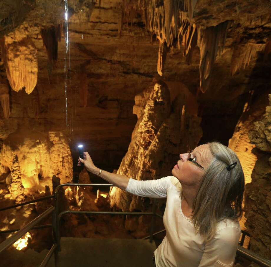 Joye Wuest of Natural Bridge Caverns traces water flowing into the cavern. Photo: Express-News File Photo / © 2012 San Antonio Express-News
