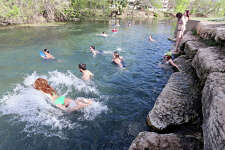 People play in the San Marcos River Monday March 18, 2013 in San Marcos, Tx.