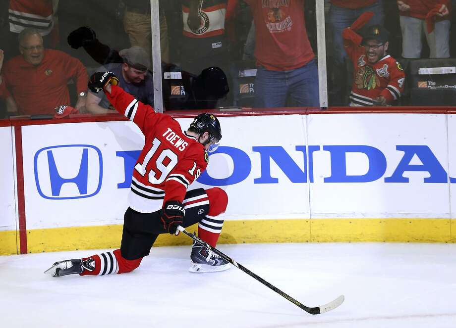 Center Jonathan Toews celebrates his goal that put Chicago in front 3-1 in the third period. Photo: Charles Rex Arbogast, Associated Press