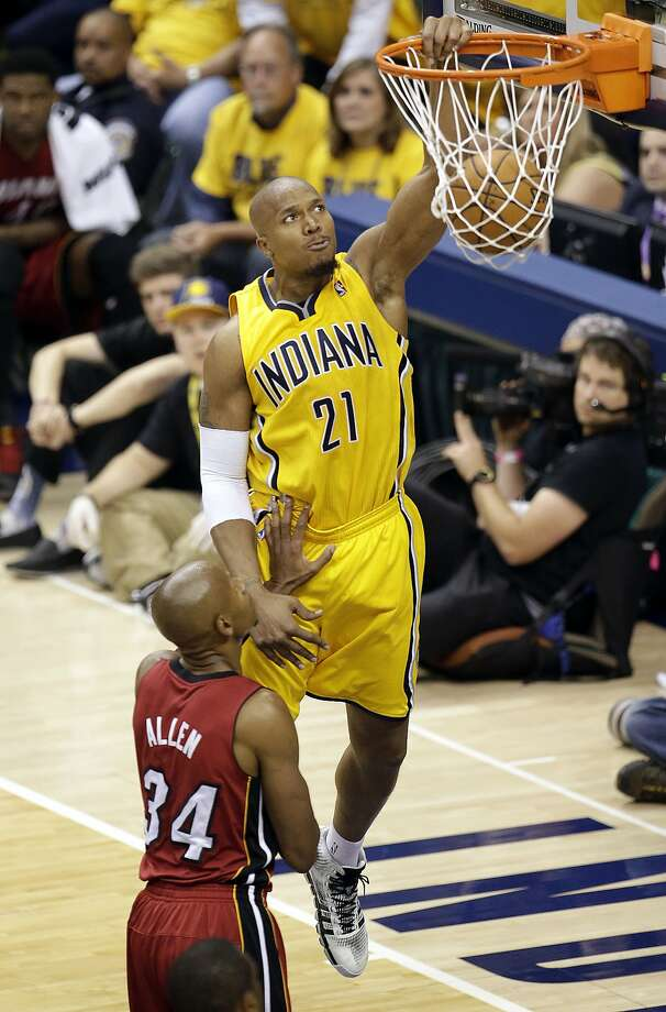 Indiana Pacers forward David West (21) dunks in front of Miami Heat guard Ray Allen (34) during the second half of Game 1 of the Eastern Conference finals NBA basketball playoff series, Sunday, May 18, 2014, in Indianapolis.The pacers won 107-96. West had 19 points. (AP Photo/AJ Mast) Photo: AJ Mast, Associated Press