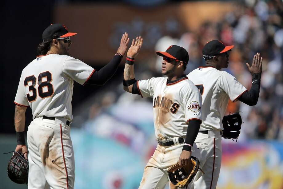 Michael Morse (38) high fives Gregor Blanco (7) after the game on Sunday. The San Francisco Giants played the Miami Marlins at AT&T Park in San Francisco, Calif., on Sunday, May 18, 2014. The Giants won 4-1. Photo: Carlos Avila Gonzalez, The Chronicle