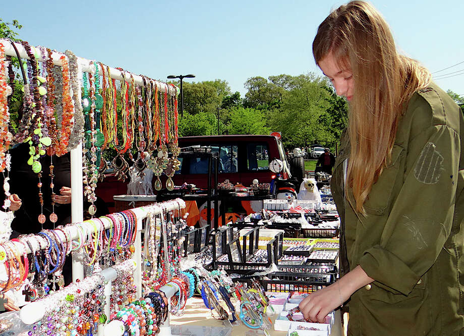 Diana Brisca of Fairfield browses through jewelry at Fairfield Warde High School PTA's outdoor flea market Sunday. Photo: Mike Lauterborn / Fairfield Citizen