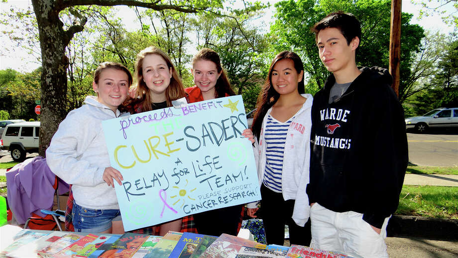 Students Kayla Yaverski, 15; Anna Green, 14; Natalia Zhiltsova, 15; Morgan Lee, 14, and Max Moon, 14, sell baked goods and books for their Relay for Life team at Fairfield Warde High School PTA's flea market Sunday. Photo: Mike Lauterborn / Fairfield Citizen