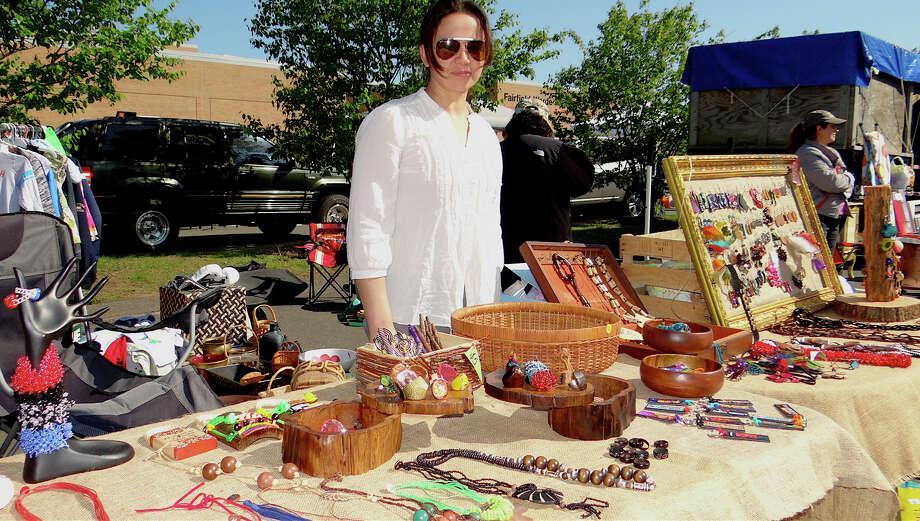 Iliana Orszag of Fairfield sells wares imported from Colombia at Fairfield Warde High School PTA's flea market. Photo: Mike Lauterborn / Fairfield Citizen