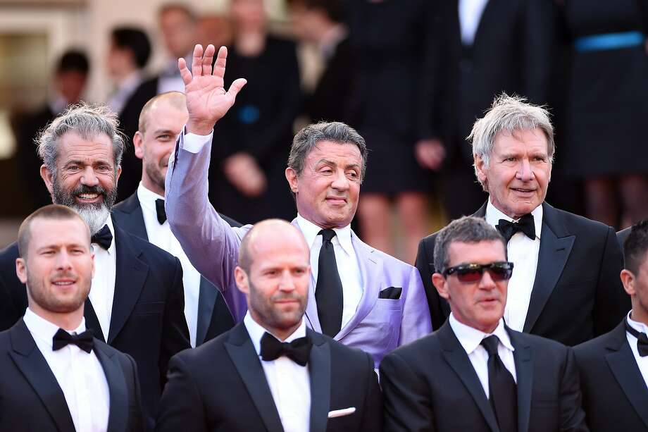 "Actor Mel Gibson, director Patrick Hughes, actors Sylvester Stallone, Harrison Ford, (Front Row L-R) Actors Glen Powell, Jason Statham and Antonio Banderas attend ""The Expendables 3"" premiere during the 67th Annual Cannes Film Festival on May 18, 2014 in Cannes, France. Photo: Gareth Cattermole, Getty Images"