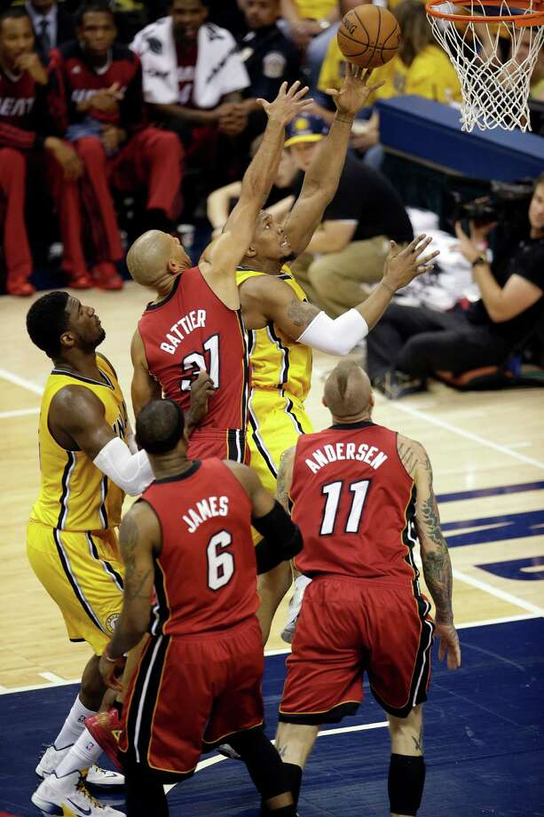 Indiana Pacers forward David West, right, shots under the defense of Miami Heat forward Shane Battier (31) during the second half of Game 1 of the Eastern Conference finals NBA basketball playoff series Sunday, May 18, 2014, in Indianapolis. The Pacers won 107-96. West had 19 points. (AP Photo/AJ Mast)  ORG XMIT: NAF215 Photo: AJ Mast / FR123854 AP