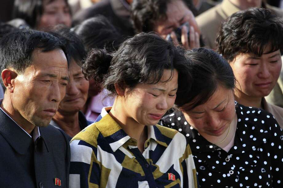 "In this Saturday, May 17, 2014 photo, families of victims of an accident at an apartment construction site in Pyongyang, North Korea grieve during a gathering in the capital where senior officials apologized and took responsibility. The word of the collapse in the secretive nation's capital was reported Sunday morning by the North's official Korean Central News Agency, which gave no death toll but said that the accident was ""serious"" and upset North Korea's leader, Kim Jong Un. (AP Photo/Jon Chol Jin) Photo: Jon Chol Jin, STF / AP"