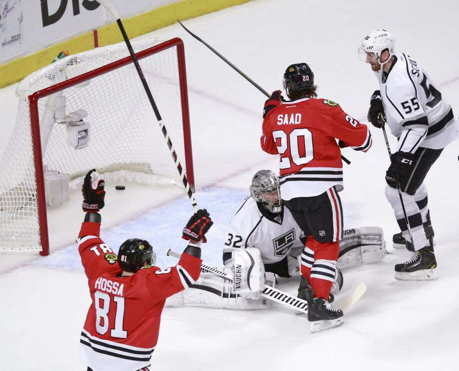 Chicago Blackhawks right wing Marian Hossa (81) celebrates Brandon Saad's goal past Los Angeles Kings goalie Jonathan Quick, as Jeff Schultz (55) watches  during the first period of Game 1 of the Western Conference finals in the NHL hockey Stanley Cup playoffs in Chicago on Sunday, May 18, 2014. (AP Photo/Charles Rex Arbogast) ORG XMIT: ILCA111 Photo: Charles Rex Arbogast / AP