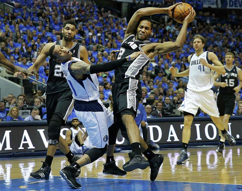 The Spurs' Kawhi Leonard, right, has been a force in the playoffs, averaging 14 points and 7.5 rebounds, and is about to play in his third conference finals in as many NBA seasons. Photo: Tom Fox, MBR / Dallas Morning News