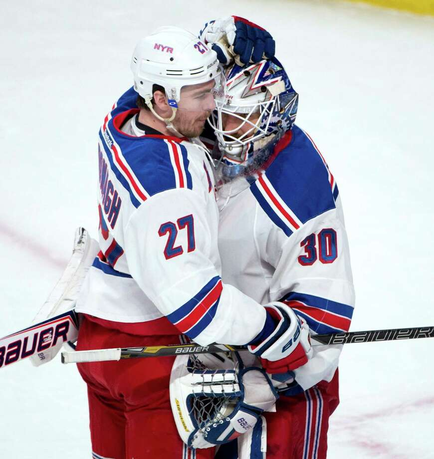 New York Rangers defenseman Ryan McDonagh, left, embraces goalie Henrik Lundqvist after their 7-2 win over the Montreal Canadiens in Game 1 of the Eastern Conference finals in the NHL hockey Stanley Cup playoffs in Montreal on Saturday, May 17, 2014. (AP Photo/The Canadian Press, Adrian Wyld) ORG XMIT: AJW109 Photo: Adrian Wyld / CP
