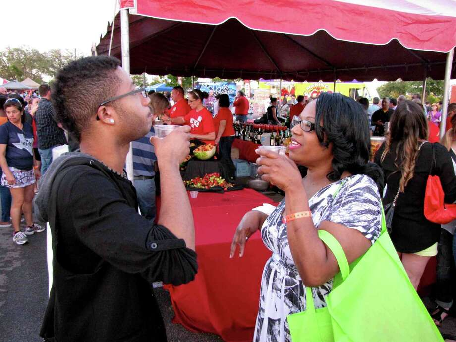 Lisa Brown and her son, Xavier, who live on the far Northwest Side, sample wine Thursday during the Food Truck Event presented by H-E-B as part of Culinaria Festival Week. Hundreds of people enjoyed dishes from a variety of food trucks at the Alon Town Centre, 1003 N.W. Military Highway, where the food truck event was held. Photo: Edmond Ortiz / Alamo Heights Weekly