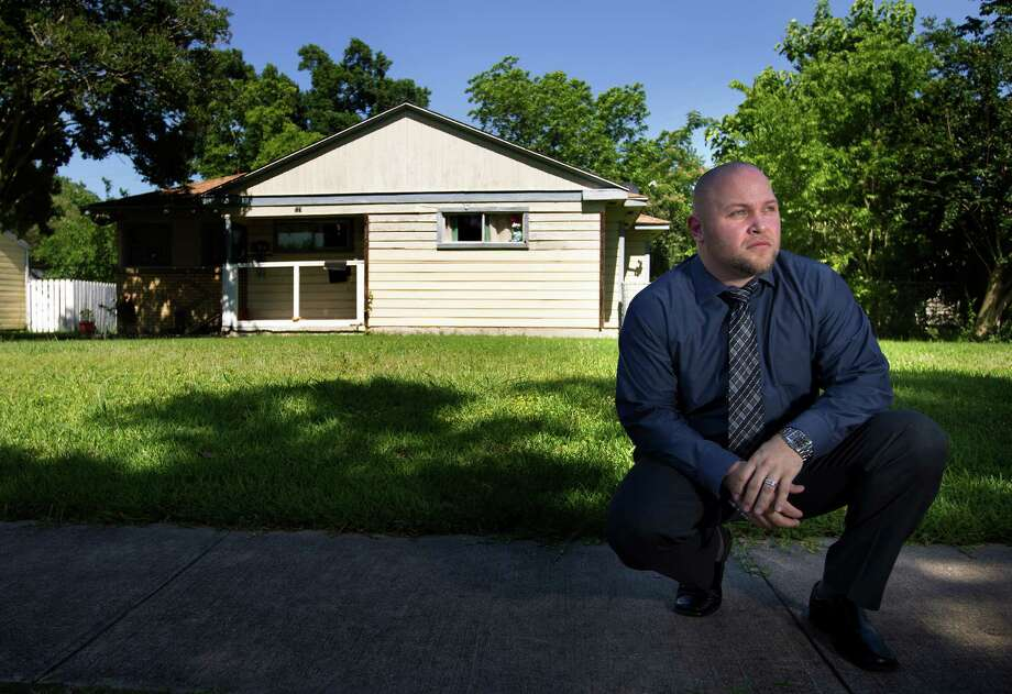 Harris County's Gang Coordinator James Odom grew up in this home, which was once riddled with bullets when he lived there as a gang member. Photo: Cody Duty, Staff / © 2014 Houston Chronicle