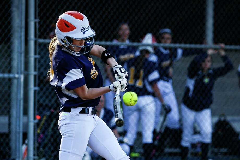 Averill Park's  McKenzie Bump flexes the bat as she makes contact during the girls' softball game against Columbia on Monday, April 28, 2014 in Averill Park, N.Y. (Dan Little / Special to the Times Union) Photo: Dan Little / Dan Little