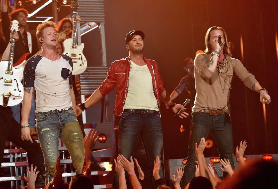 (L-R) Musicians Brian Kelley, Tyler Hubbard of Florida Georgia Line and Luke Bryan (center) perform onstage during the 2014 Billboard Music Awards at the MGM Grand Garden Arena on May 18, 2014 in Las Vegas, Nevada. Photo: Kevin Winter/Billboard Awards 2014, Getty Images / 2014 Kevin Winter/Billboard Awards 2014