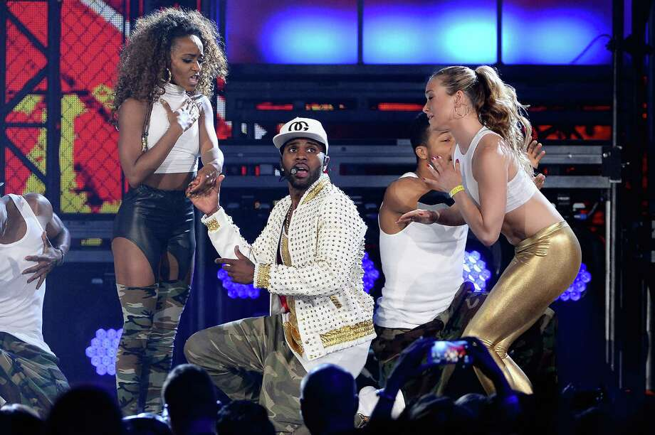 Singer Jason Derulo (center) performs onstage during the 2014 Billboard Music Awards at the MGM Grand Garden Arena on May 18, 2014 in Las Vegas, Nevada. Photo: Ethan Miller, Getty Images / 2014 Getty Images