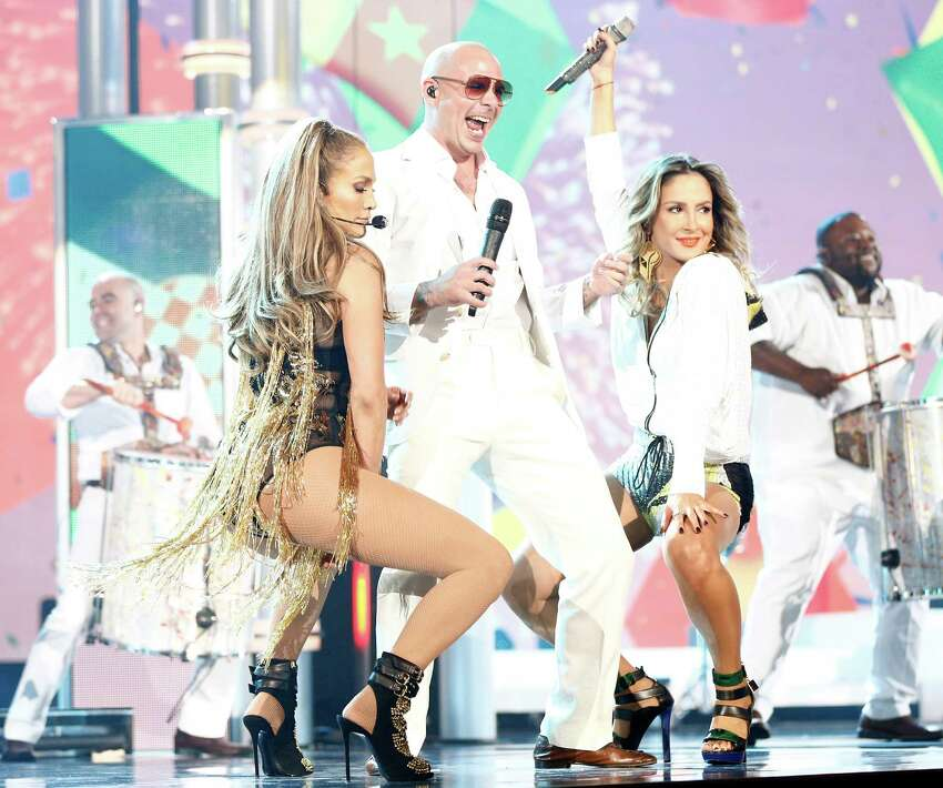 (L-R) Recording artists Jennifer Lopez, Pitbull and Cláudia Leitte perform onstage during the 2014 Billboard Music Awards at the MGM Grand Garden Arena on May 18, 2014 in Las Vegas, Nevada.