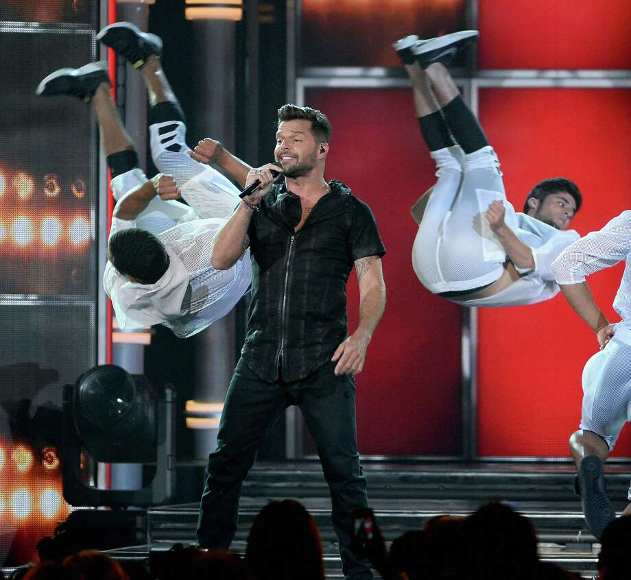 Singer Ricky Martin performs onstage during the 2014 Billboard Music Awards at the MGM Grand Garden Arena on May 18, 2014 in Las Vegas, Nevada. Photo: Ethan Miller, Getty Images / 2014 Getty Images