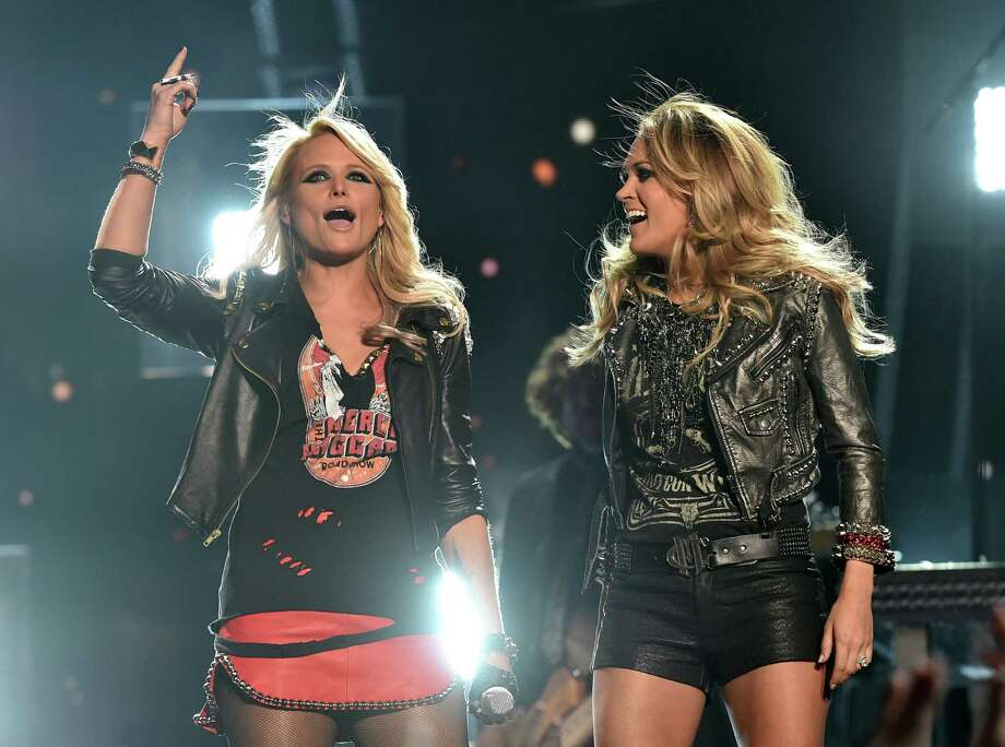 (L-R) Singers Miranda Lambert and Carrie Underwood perform onstage during the 2014 Billboard Music Awards at the MGM Grand Garden Arena on May 18, 2014 in Las Vegas, Nevada. Photo: Kevin Winter/Billboard Awards 2014, Getty Images / 2014 Kevin Winter/Billboard Awards 2014