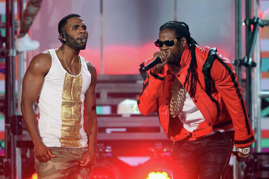 Singer Jason Derulo (L) and rapper 2 Chainz perform onstage during the 2014 Billboard Music Awards at the MGM Grand Garden Arena on May 18, 2014 in Las Vegas, Nevada. Photo: Ethan Miller, Getty Images / 2014 Getty Images
