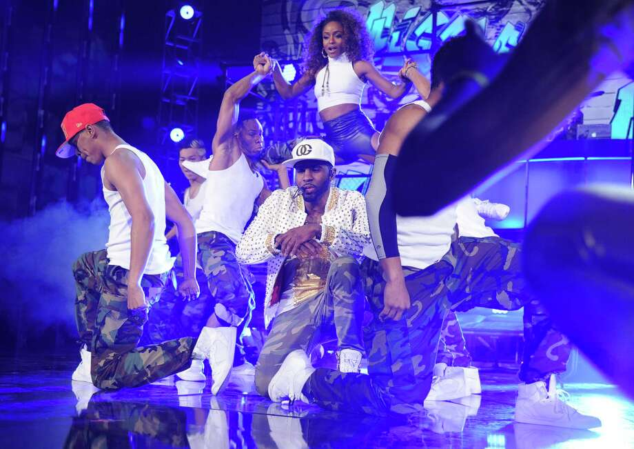 Singer Jason Derulo (center) performs onstage during the 2014 Billboard Music Awards at the MGM Grand Garden Arena on May 18, 2014 in Las Vegas, Nevada. Photo: Kevin Winter/Billboard Awards 2014, Getty Images / 2014 Kevin Winter/Billboard Awards 2014