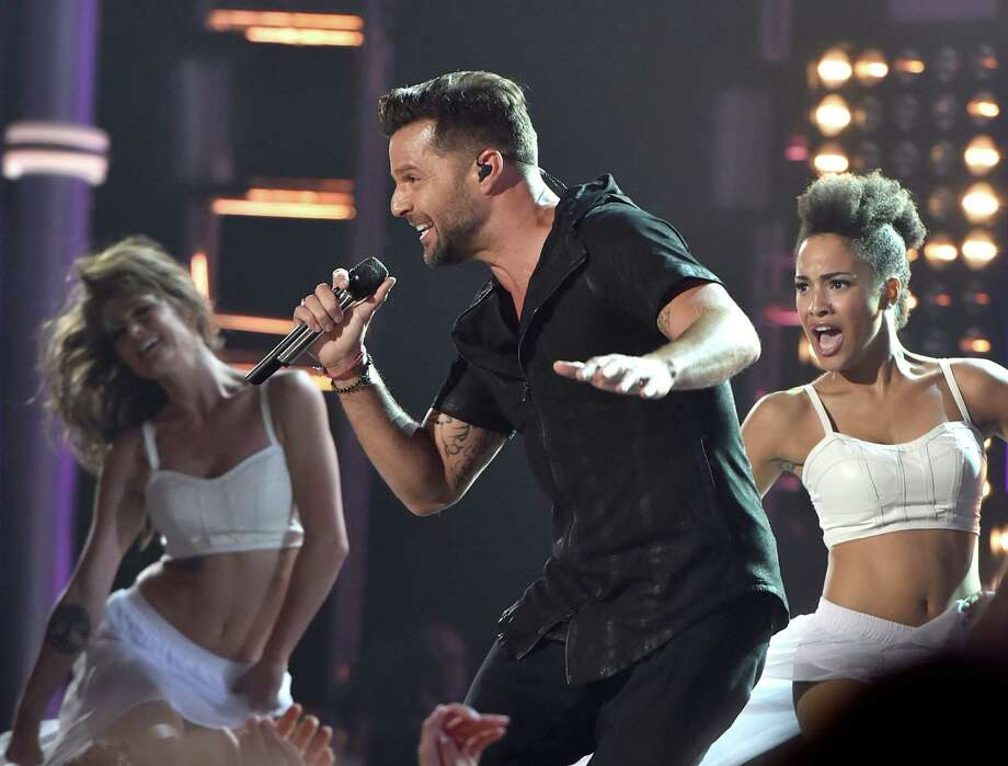Recording artist Ricky Martin (C) performs onstage during the 2014 Billboard Music Awards at the MGM Grand Garden Arena on May 18, 2014 in Las Vegas, Nevada. Photo: Kevin Winter/Billboard Awards 2014, Getty Images / 2014 Kevin Winter/Billboard Awards 2014