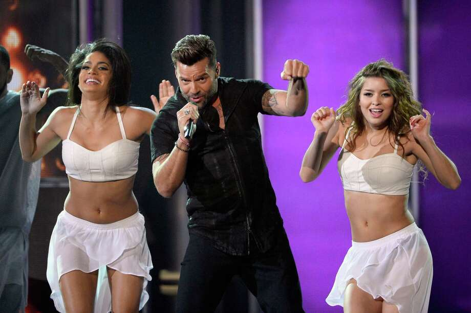 Recording artist Ricky Martin (C) performs onstage during the 2014 Billboard Music Awards at the MGM Grand Garden Arena on May 18, 2014 in Las Vegas, Nevada. Photo: Ethan Miller, Getty Images / 2014 Getty Images