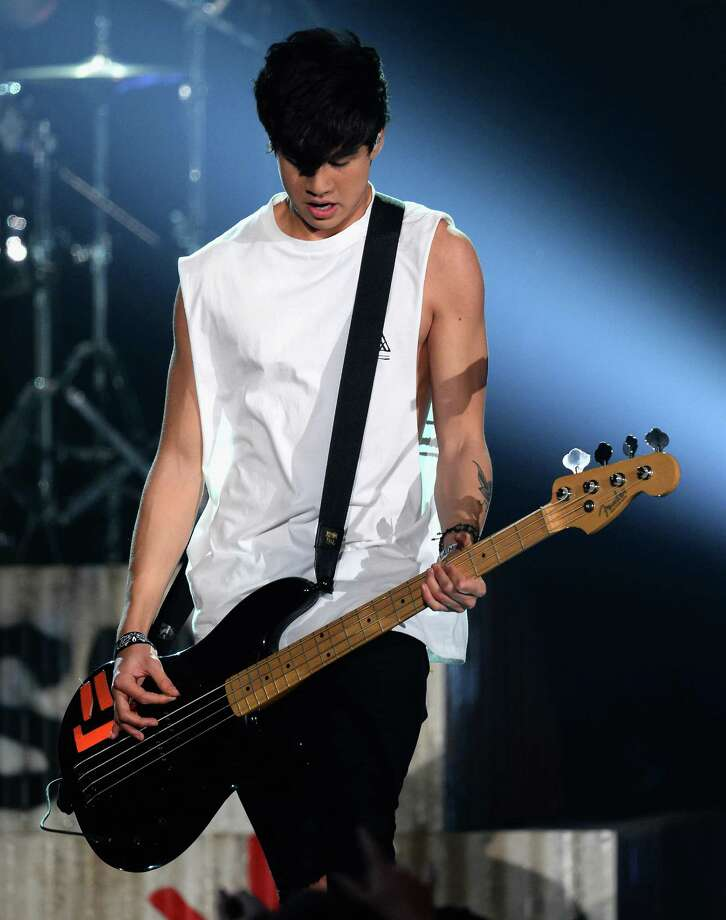 Recording artist Calum Hood of 5 Seconds of Summer performs onstage during the 2014 Billboard Music Awards at the MGM Grand Garden Arena on May 18, 2014 in Las Vegas, Nevada. Photo: Ethan Miller, Getty Images / 2014 Getty Images