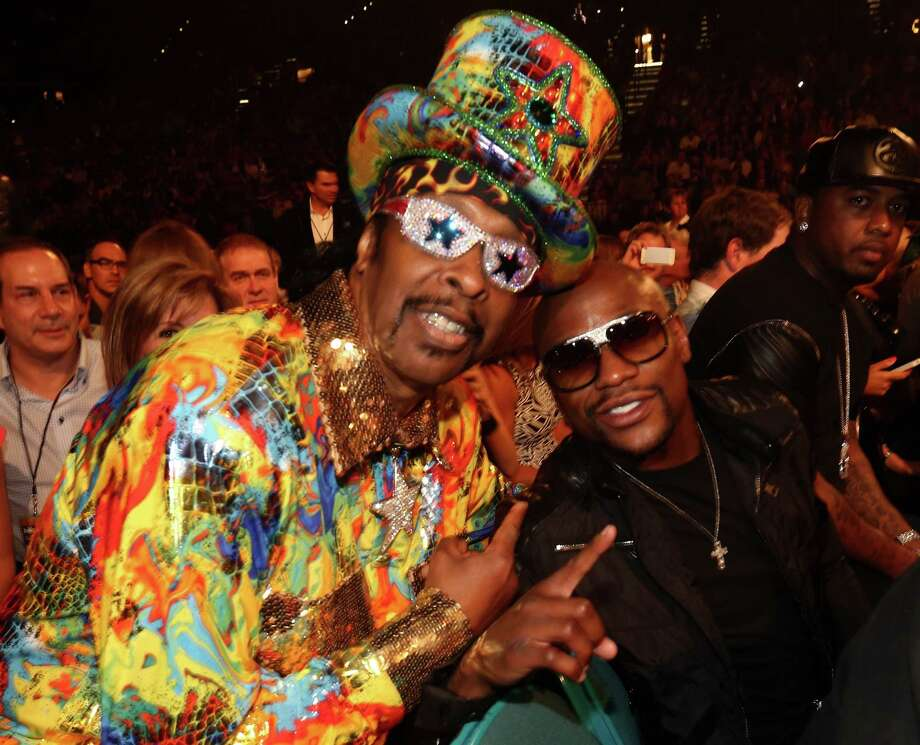 Recording artist Bootsy Collins (L) and boxer Floyd Mayweather Jr. attend the 2014 Billboard Music Awards at the MGM Grand Garden Arena on May 18, 2014 in Las Vegas, Nevada. Photo: Christopher Polk/Billboard Awards 2014, Getty Images / 2014 Christopher Polk/Billboard Awards 2014