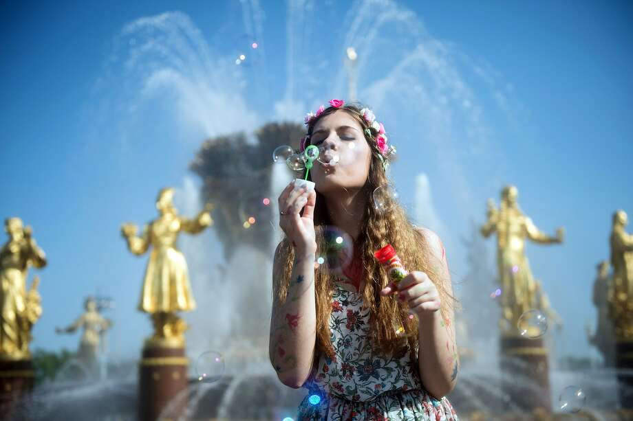 A girl blows bubbles during the Dreamflash soap bubble festival in Moscow. Photo: Alexander Utkin, AFP/Getty Images