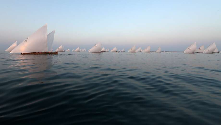 Everything you could ask for in a regatta except for wind:Emiratis sail in the Al-Gaffal traditional long-distance dhow race between the island of Sir Bu Nair, near the Iranian coast, and the Gulf emirate. The race,   known as the Gaffal, has a total of 10 million dirhams ($272,000) in prizes. Photo: Karim Sahib, AFP/Getty Images