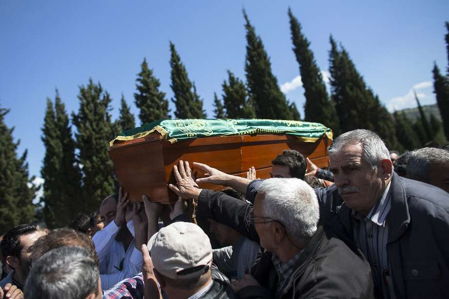*** BESTPIX *** SOMA, TURKEY - MAY 18:  Friends and relatives of the miners who died in an explosion at the Soma mine perform a burial in Soma cemetery of the last body to be recovered from the mine, on May 18, 2014 in Soma, Turkey. Rescuers are still trying to reach parts of the coal mine in Soma days after fire knocked out power and shut down the ventilation shafts and elevators, trapping hundreds underground. At least 298 people have been confirmed dead, mostly from carbon monoxide poisoning, and hopes are fading of pulling out any more alive of those still thought to be inside.  (Photo by Oli Scarff/Getty Images) Photo: Oli Scarff, Getty Images