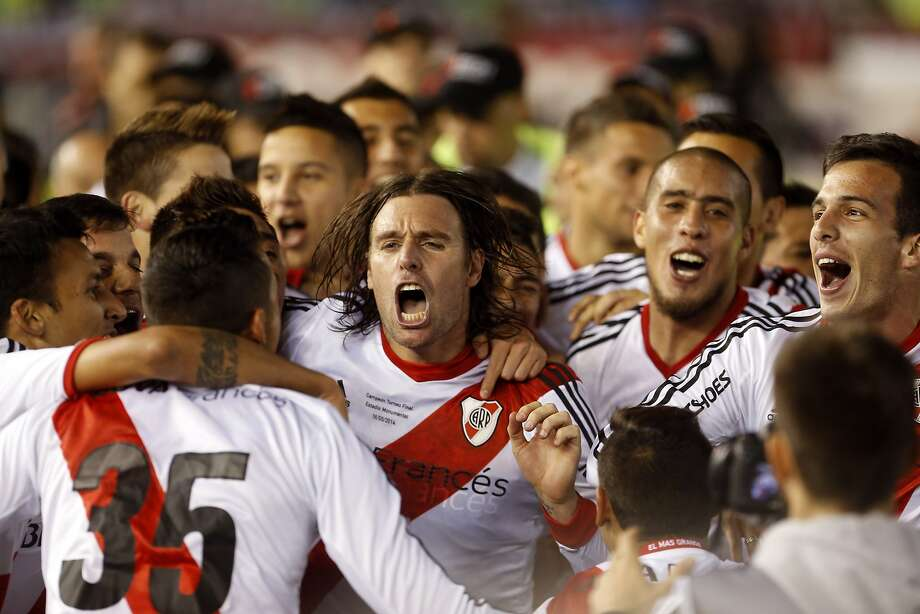 River Plate's Fernando Cavenaghi, center, celebrates with his teammates after winning the Argentine league soccer championship, defeating Quilmes in Buenos Aires, Argentina, Sunday, May 18, 2014. (AP Photo/Victor R. Caivano) Photo: Victor R. Caivano, Associated Press