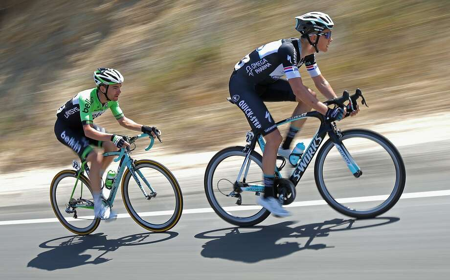 SACRAMENTO, CA - MAY 18: Niki Terpstra (R) of the Netherlands riding for the Omega Pharma-Quickstep Cycling Team and Jack Bobridge (L) of Australia riding for the Belkin-Pro Cycling Team are the last two members of the breakaway during stage eight of the 2014 Amgen Tour of California on May 18, 2014 in Thousand Oaks, California. Bobridge was awarded the most courageous rider's jersey for the stage.  (Photo by Doug Pensinger/Getty Images) Photo: Doug Pensinger, Getty Images